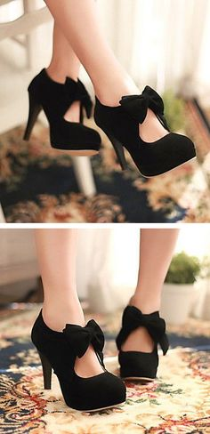 Cute, black, heeled, and with bows. What more can a girl ask for? Besides a matching dress.