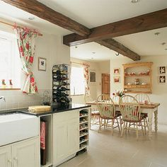 several coats of Farrow  Ball's Dimity paint have given these old wooden kitchen units a new lease of life.
