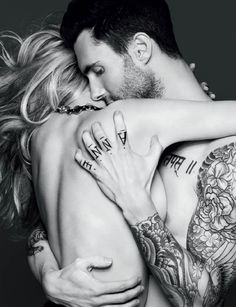 I could never have my hands inked... but I like the commitment it shows. I absolutely adore the angle and depth of this photo. The direction of his eyes and how he's gripping her without distorting her skin... beautiful. Adam is one gorgeous man.