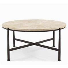 This round cocktail table features a saltillo travetine top with cast iron metal base with X-stretcher. Add a contemporary accent to your home with this cocktail table.