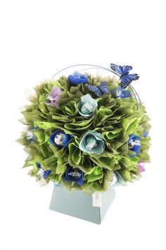 Beautiful Bluebell Woods Chocolate Bouquet by The Chocolate Florist. Embellished with Lindt and Ferrero Rocher Chocolates Visit www.thechocolateflorist.co.uk for more details
