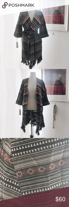 BB Dakota Jacket This brand new BB Dakota still has tags attached. Size small. Tribal pattern. Features fringe on bottom that goes all around. Wear closed with the belt or open like a kimono. Looks so good with leggings or over a dress. Has pockets. 🌹feel free to make an offer❤️ BB Dakota Jackets & Coats Trench Coats