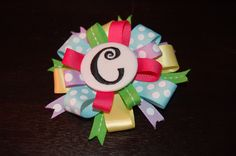'Crazy Bow' with initial pin.  Bow w/ Initial Pin - $8