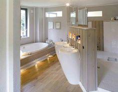 Luxus Raum: moderne Badezimmer von Haacke Haus GmbH Co. KG