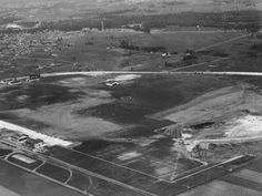 Minneapolis-St. Paul International Airport was initially known as Speedway Field in reference to its auto-racing history. In this circa 1930 photo, you can see oval outlines from the former raceway.  Minneapolis-St. Paul International Airport