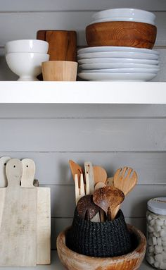 open shelves / white / natural / wooden spoons