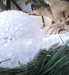 "DIY Epsom Salt Ornament  ""crackled crystal"" snowball ornament: Add a little water to a bowl of Mod Podge, just enough to thin it out a bit. Pour a little in a clear glass ornament, swirl it around to coat the inside, & let the excess drip out. Pour some epsom salt into the ornatment (and maybe a bit of silver gitter as well?), shake it up to coat the inside of the ornament. Let dry."