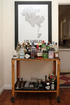 love the bar cart - and the poster