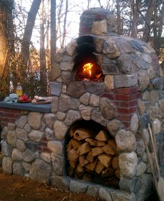 This is one of our pizza ovens. Mixing brick and stone makes any project look older and adds character.