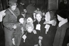 Evacuated Finnish children arriving in Sweden, met by Swedish Lottas (Swedish Women's Voluntary Defense). - Finland