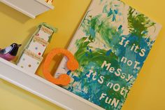 "Love this do it their self craft for kids. Use letter stickers on canvas, let them paint and then peel off the stickers. Love Kris' version, ""Excuse the mess, Grady is making memories."""