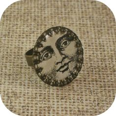 Aged brass bezel and resin vintage Victorian moon face adjustable ring. $15.00, via Etsy.