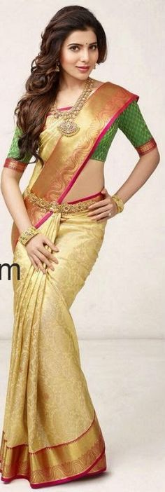Love this gold silk saree and blouse. Team it with statement necklace, kangan and kamarbandh.