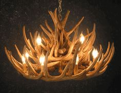 Whitetail 21 Antler Cascade Chandelier by Black Forest Decor.  Faux antlers.    http://www.blackforestdecor.com