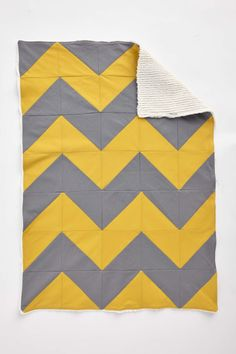 Baby quilt in cool mustard and grey chevrons with soft brushed cotton backing by @Manda M. McGrory   From issue 4 of Love Patchwork & Quilting. Photo © Love Patchwork & Quilting