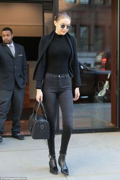 On the dark side: The 22-year-old wore a cardigan over a turtleneck, trendy high-waist ski... #gigihadid