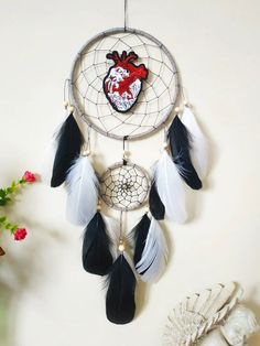 Anatomical heart black and white Dream Catcher wall hanging, Dreamcatcher bedroom wall decor Made with attention and love this dream catcher brings its owners good dreams and positive energy. A one-of-a-kind, cool interpretation of the traditional dream catcher. The perfect gift to your favorite person and a perfect wall decoration to complement a bedroom, dorm room or nursery. Handcrafted with positive thoughts. Dream Catcher Decor, Black Dream Catcher, Anatomical Heart, Heart Art, Favorite Person, Wooden Beads, Silver Beads, Feather, Positive Thoughts