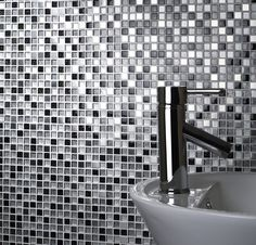 The stardust glass & metal mosaic tile can add a contemporary look to any bathroom, kitchen or wet room. This mosaic sheet size is 30 x 30 cm and is a mixture of glass & metal, it has meshed backing. These mosaics can be used as a full sheet, or cut down to make a cost effective decorative feature, such as a border for a bathroom or wet room.