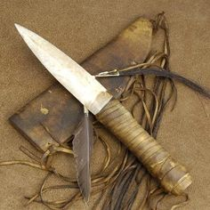 Decorative American Sioux Indian bone dagger knife with buckskin leather sheath. This dagger knife measures inches overall. Patterned after the Teton Sioux Indian weapons, this bone dagger artifact is an impressive piece that belongs in your collection. Sioux, Trench Knife, Dagger Knife, Indian Artifacts, Knife Sheath, Knife Sharpening, Survival Knife, Survival Weapons, Survival Food