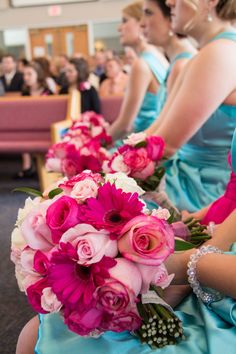 Love the pink bouquets with the aqua blue bridesmaids dresses! Photo by Jeannine. #MinneapolisWeddingFlorists
