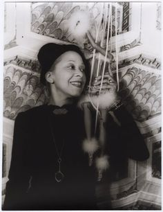 "Nora Holt, photographed with a marionette by Carl Van Vechten on August 29, 1937, was first African American to earn a master's degree in music (Chicago Musical College, 1918) She was a music critic for two preeminent black newspapers, the Chicago Defender and the New York Amsterdam News. Married five (or more) times, she was a regular in the gossip columns thanks to her love life. Ms. Holt was said to be the inspiration for the ""Lasca Sartoris"" character in Van Vechten's ""N****r Heaven."""