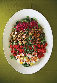 This salad is topped with a bright thick sweet-tart pickled beet dressing.
