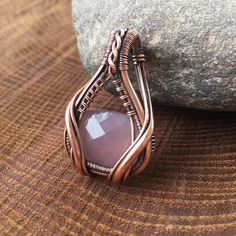 I adore this wire wrapped pendant! This pendant features a beautiful faceted rose quartz cabochon that has been wrapped up in yards and yards of raw copper that has been antiqued and polished to highlight the details of the wire work. This wire wrap measures 1 1/2 inches long by
