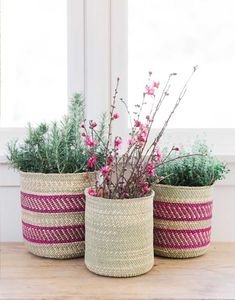 Organize in style with these hand-woven baskets. Available in three sizes, they are useful in every room of the home.