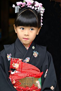 Taken during the Shichi-go-san celebration. Japan Boys and girls go to visit a shinto shrine with their parents to pray for health.