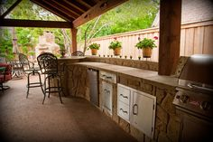 Another example of a functional, yet beautiful outdoor kitchen. This one includes stainless BBQ, refrigerator and lots of extra storage in the form of drawers and cabinets. By Outdoor Signature in Argyle, TX