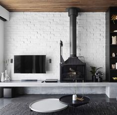 Fireplace design by Check out Our Radiant 747 making a bold and beautiful statement in this coastal home - featured in Photographer: . Wood Burner Fireplace, Open Fireplace, Fireplace Wall, Living Room With Fireplace, Fireplace Design, Fireplace Ideas, Concrete Houses, A Frame Cabin, Weekend House