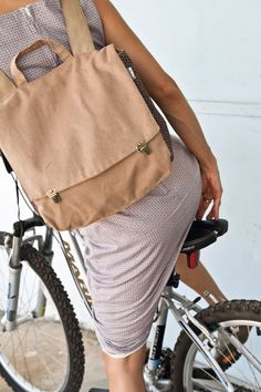 Khaki Canvas Satchel Backpack by Badimyon    This lovely satchel backpack bag is a classic and nostalgic one. The bag closes with 2 front bronze clips