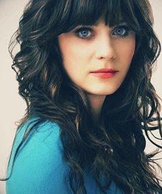 Zooey Deschanel- Straight bangs with curly hair is possible. Not that I could ever look THIS GOOD!!