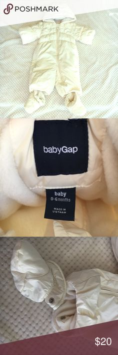 Gap baby snow suit Cute white/cream baby puffer snow suit, super warm!. Comes with booties, no gloves, booties snap into suit to avoid loosing them. Worn one time, we live in Colorado and had a super warm winter- used one time- perfect condition. GAP Jackets & Coats Puffers