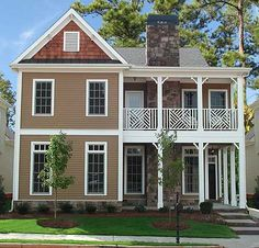 Architectural Designs House Plan 15891GE. Cute with stacked porches. Up to 5 bedrooms or 4 and a loft.