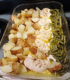 Simple Green Beans, Chicken & Potato Dish 2 cans drained green beans 4 boneless chicken breasts 5 cubed par boiled potatoes Spray casserole dish Place green beans on one side Chicken breasts in middle Potatoes on the other side  Sprinkle with one packet dry Italian dressing mix Drizzle with 1/2 stick melted butter Cover with foil Bake @400 for 45-50 minutes