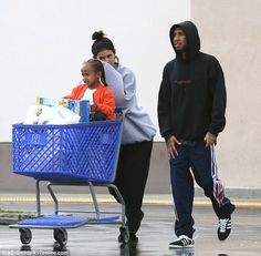 Shopping spree: Kylie Jenner and her beau Tyga spent the afternoon with the rapper's four-year-old son, King Cairo, at Toys 'R' Us in Los Angeles on Tuesday