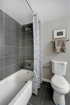 Use of large sized tiles which I like, but the grey is too dark and dominant for my small cottage bathroom.