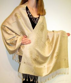 Wow My Beige & Gold Shawl Ecstacy -     Click to enlarge      This beautiful fashion shawl in Beige & Gold Pashmina Silk with unique hand crafting featuring gold paisleys and a gold border accent is designer elegance and style.
