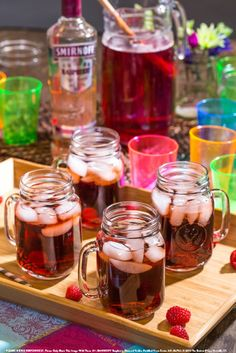 Smirnoff Razz Time with 1.5 oz SMIRNOFF® Raspberry Flavored Vodka, 0.5 oz grenadine, and 5 oz cola. Build in a mason jar and top with cola. Garnish with a cherry.