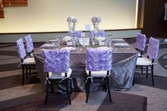 Pretty, #purple wedding chair covers! These are a fun, unique new twist to wedding seating! Find mroe wedding inspiration at the next PWG Wedding Show in Nashville! #weddingtrends #receptionideas