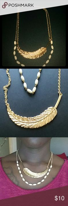 Gold Feathered Necklace Gold feather with the contribution of cream colored beading, a double sequence chain necklace. With a beautiful shine when hit by sunlight. Jewelry Necklaces