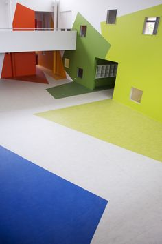 Marmoleum flooring day nursery and childcare. Playing with basic shapes and colors.