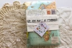 """Includes:  - Hand printed """"We are made of stardust"""" patch  - Copy of my zine, """"We Who Were"""" Color Edition  - Vintage sheet music book  - Hand made airmail pin  - Paper treats"""