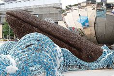 See the Whales Swimming in an Ocean of 70,000 Plastic Water Bottles