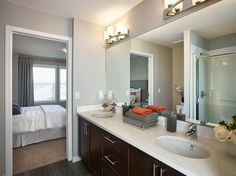 Amble Townhome Showhome - Gateway at Williamstown in Airdrie Alberta Townhouse, Mirror, Bathroom, Furniture, Design, Home Decor, Washroom, Decoration Home, Terraced House