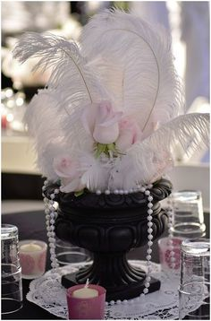 Ostrich feather & pearl centerpiece.