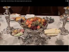 Epergne full of desserts - marzipan, candied cherries, sponge fingers...  From The Art of Dinning in 18th Century England