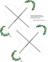 Printable miniature self closing boxes with a holly wreath on the top.