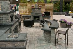 outdoor kitchen and fireplace layout. and wood screen divider. and love the pavers